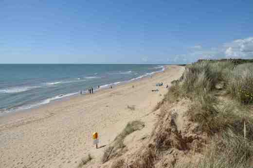 Clean sandy beach as far as the eye can see..