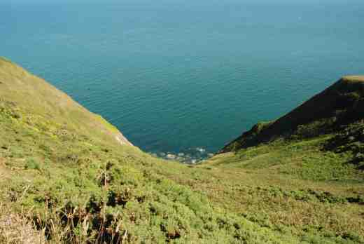 The crystal clear waters of the Irish sea, looking down the cliffs from the summit of Howth Head
