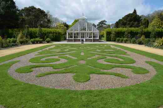 The parterre in the walled garden with the Victoria greenhouse