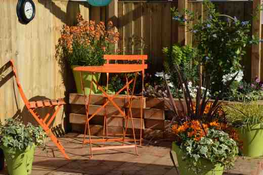 The Relaxation Garden. I love the way the flowers pick up the colour of the furniture but orange is not the most relaxing colour