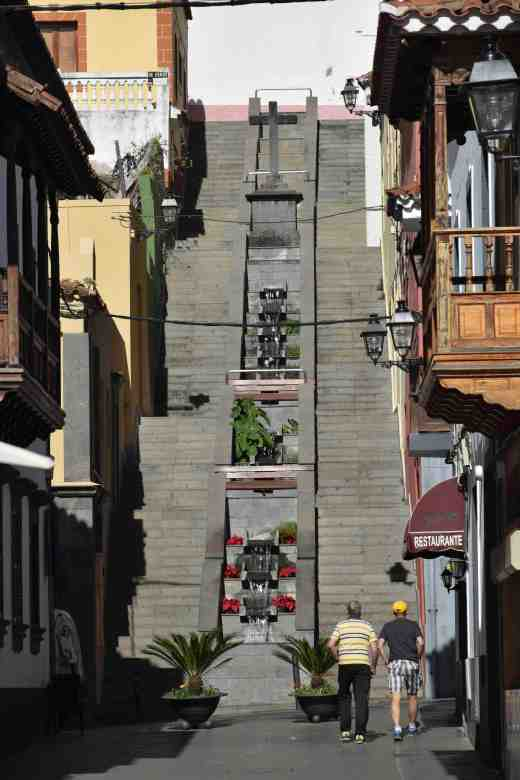 A stepped water feature down a steep street beyond the Calle de la Diputacion